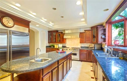 Custom designed home remodeling of kitchen using custom decor by HT Constructions, Los Angeles, CA