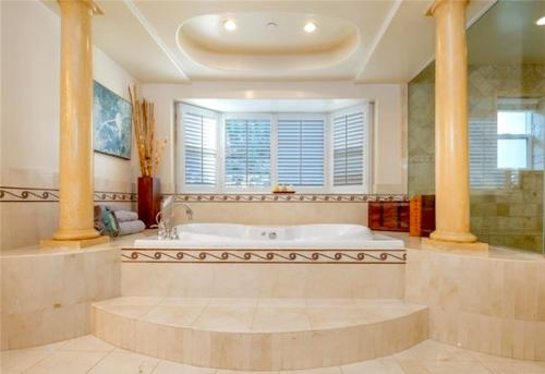 Custom bathroom designs with jacuzzi by HT Constructions, Los Angeles, CA